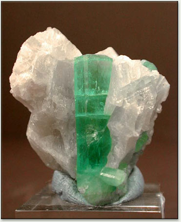 the gem peridot quality of gemstones and is pale crystals olivine variety crystalinks forsteritic gemstone green